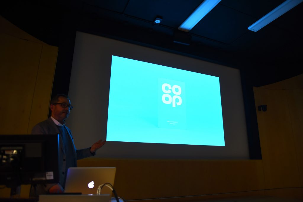 Sean Perkins giving lecture about the Co-op re-brand.